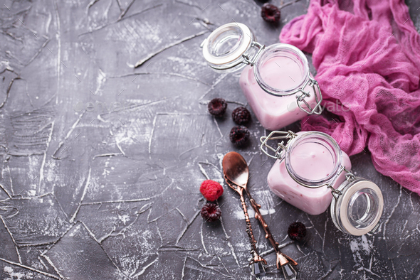 Sweet yogurt with berry in a glass jars - Stock Photo - Images