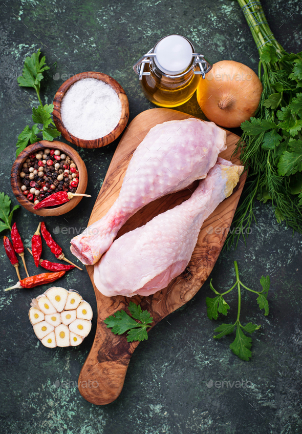Raw chicken legs with spices and garlic. - Stock Photo - Images