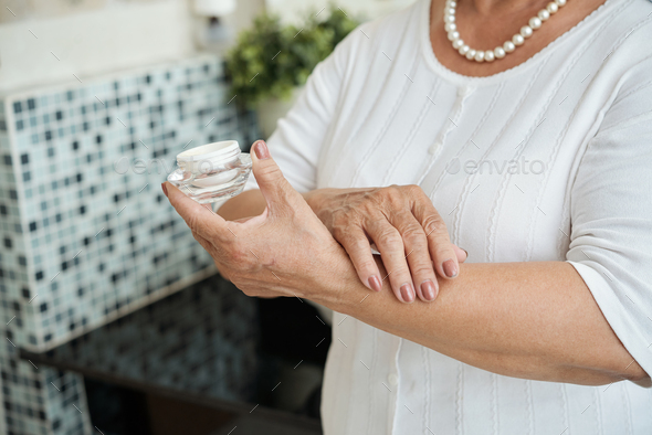 Senior woman with cream - Stock Photo - Images