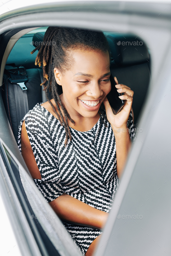 Passenger talking on the phone - Stock Photo - Images