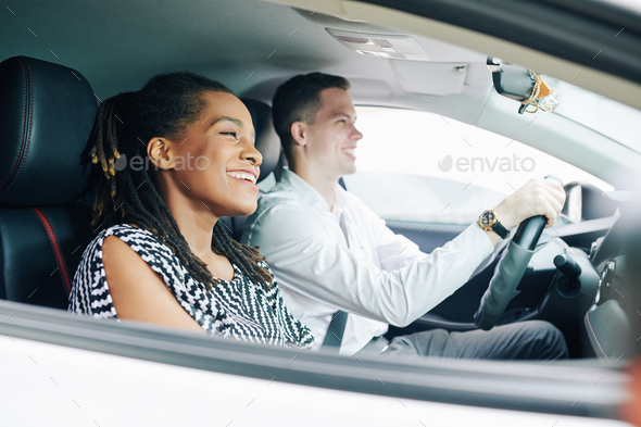 Multiethnic couple driving - Stock Photo - Images