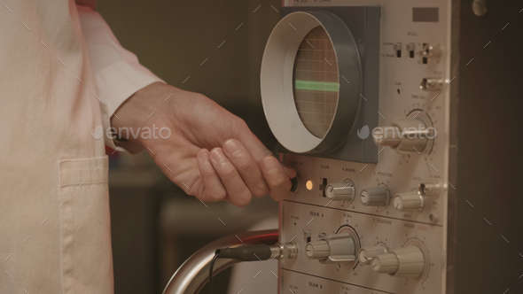 Scientist using an old machine in the laboratory - Stock Photo - Images