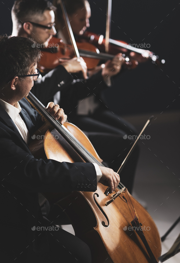 Symphonic orchestra performing on stage - Stock Photo - Images