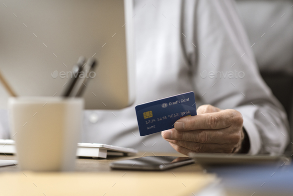 Senior man doing online shopping with a credit card - Stock Photo - Images