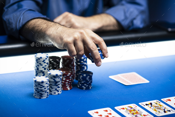 Lucky wealthy player betting chips at casino - Stock Photo - Images