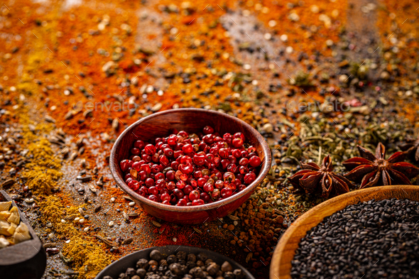 Red peppercorn in wooden bowl - Stock Photo - Images