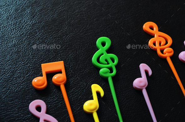 The Colorful music not on leather floor - Stock Photo - Images