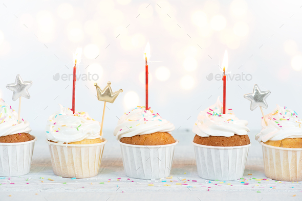 Festive Birthday Cupcakes with Candles - Stock Photo - Images
