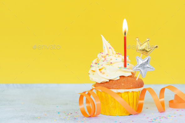 Festive Birthday Cupcake Decorated with Candle - Stock Photo - Images