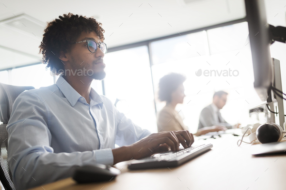 Successful group of business people at work in office - Stock Photo - Images