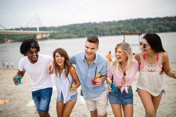 Group of friends having fun on the beach. Summer, fun, people, vacation concept - Stock Photo - Images