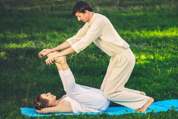 Thai massage with yoga exercises - Stock Photo - Images