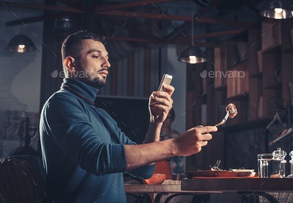 man photographing food - Stock Photo - Images