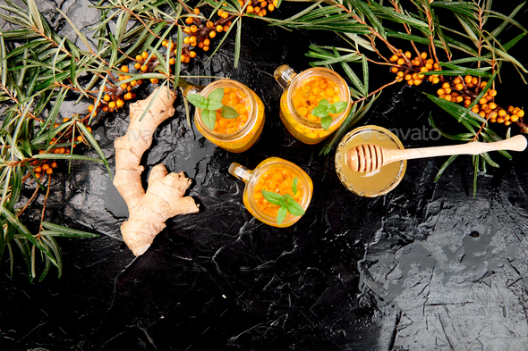 Vitaminic healthy sea buckthorn tea in small glass cups - Stock Photo - Images