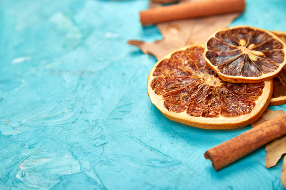 Autumn composition background with slices of dried oranges, leaves and cinnamon. - Stock Photo - Images
