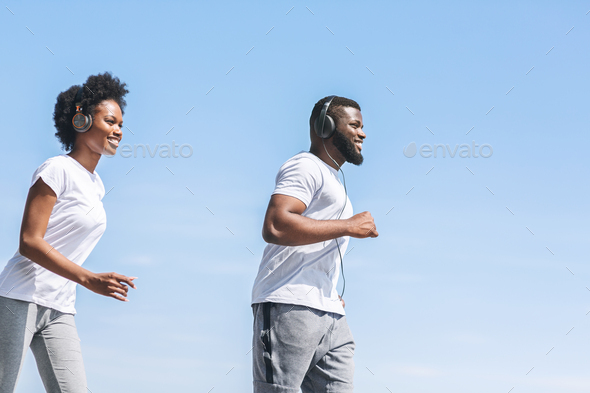 Smiling Afro Spouses Jogging Outside In The Morning - Stock Photo - Images