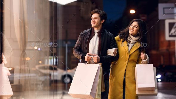 Happy couple after successful shopping, walking outdoors - Stock Photo - Images