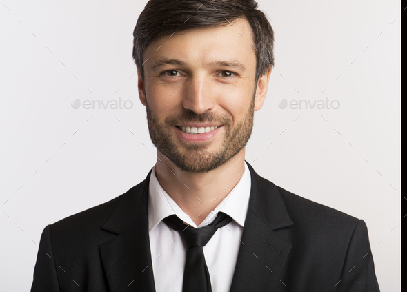 Smiling Businessman Looking At Camera On White Background, Isolated - Stock Photo - Images