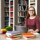 Young female scientist smiling at camera, studying at library - PhotoDune Item for Sale