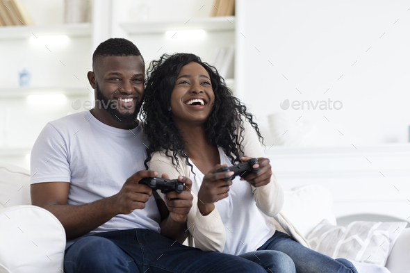 Happy Black Couple Enjoying Playing Video Games Together - Stock Photo - Images