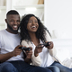 Happy Black Couple Enjoying Playing Video Games Together - PhotoDune Item for Sale