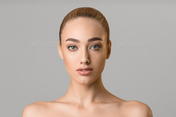 Natural beauty. Young woman with clean fresh skin - Stock Photo - Images