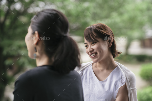 two young japanese woman talking - Stock Photo - Images