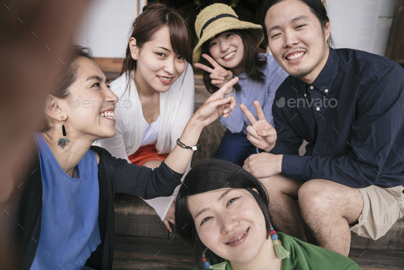 Group of Japanese tourists taking pictures - Stock Photo - Images