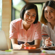 Asian female graphic designer working together at the office They use laptop and tablet. - PhotoDune Item for Sale