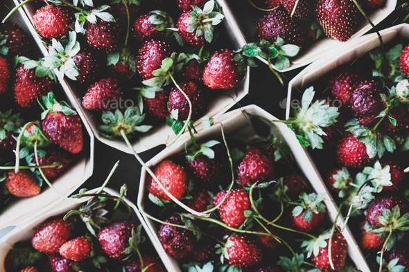 Food texture, background, wallpaper with fresh garden strawberries in boxes - Stock Photo - Images