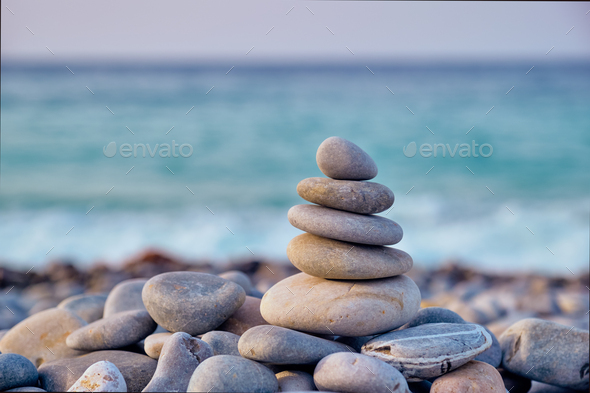 Zen balanced stones stack on beach - Stock Photo - Images