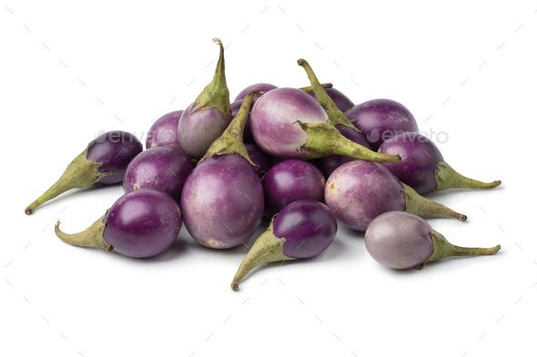 Heap of fresh raw purple mini eggplants - Stock Photo - Images