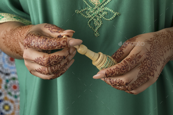 Moroccan woman with henna painted hands - Stock Photo - Images