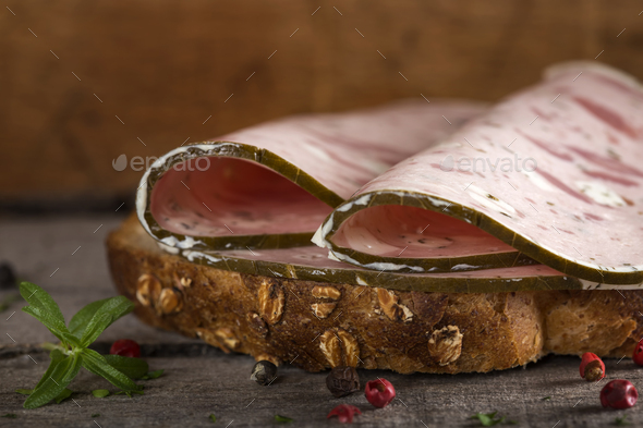 sandwich with specialty ham or salami made with pork meat and sheep cheese - Stock Photo - Images