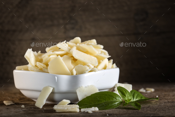 parmesan cheese flakes and basil - Stock Photo - Images