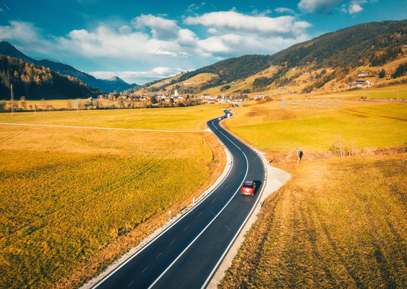 Aerial view of the road in mountain valley at sunset in autumn - Stock Photo - Images