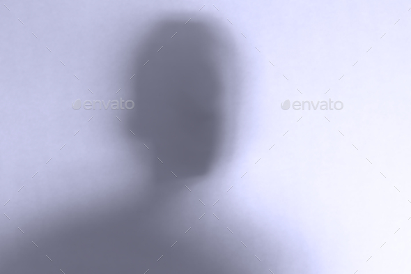 Defocused scary ghost face behind a white glass background - Stock Photo - Images