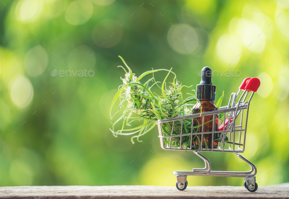 cannabis with cannabidiol (cbd) extract in a shopping cart - Stock Photo - Images
