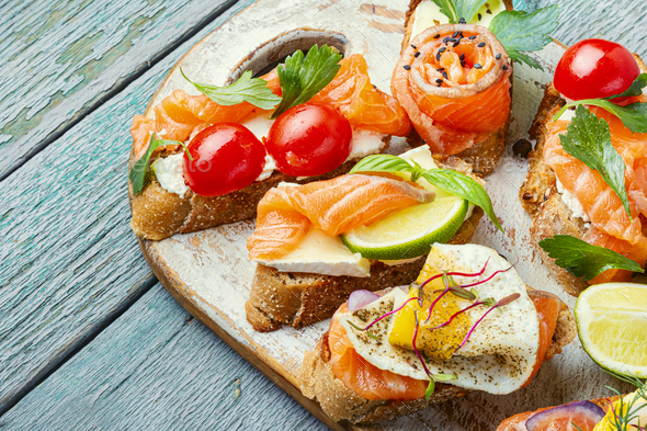 Toasts with salted salmon - Stock Photo - Images