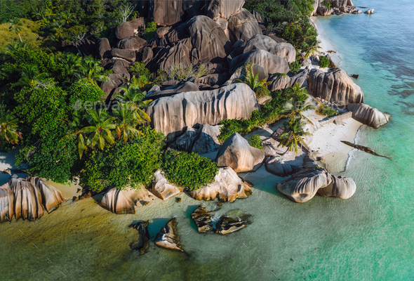 Aerial photo of Seychelles tropical beach Anse Source d'Argent in evening light at La Digue - Stock Photo - Images
