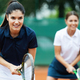 Young happy fit women playing tennis on tennis court - PhotoDune Item for Sale