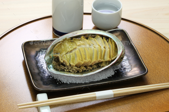 steamed abalone with sake, japanese cuisine - Stock Photo - Images