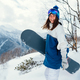 laughing happy girl with a snowboard and background of mountains - PhotoDune Item for Sale