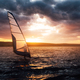 Windsurfing on a lake at sunset. - PhotoDune Item for Sale