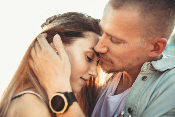 Tanned young caucasian couple, modern lovestory in film grain effect - Stock Photo - Images