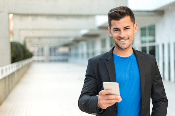 man close up with a mobile phone - Stock Photo - Images