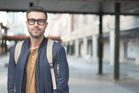 man with backpack smiling student - Stock Photo - Images