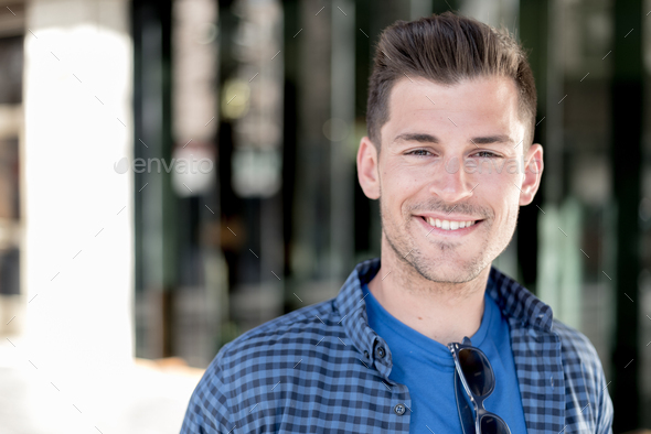 man close up smiling to the camera - Stock Photo - Images