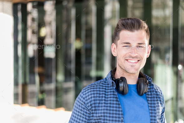 Man close up with headphones smiling - Stock Photo - Images