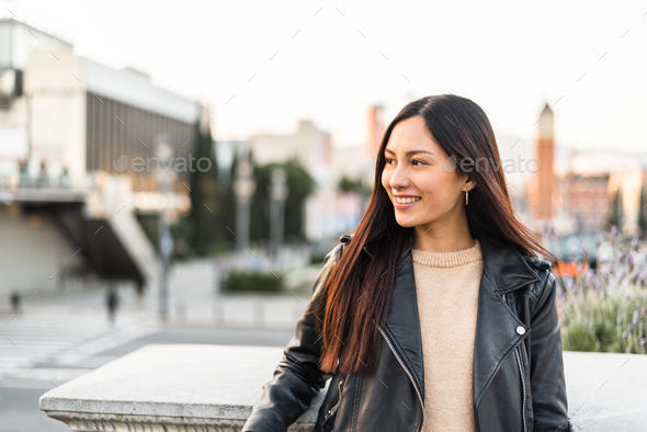 Korean young woman close-up looking at the camera smiling and ha - Stock Photo - Images